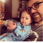 baby holds cup