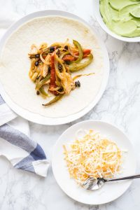 Chicken fajitas with avocado sauce and cheddar cheese