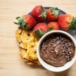 brownie batter hummus in a bowl with pretzel crackers and strawberries
