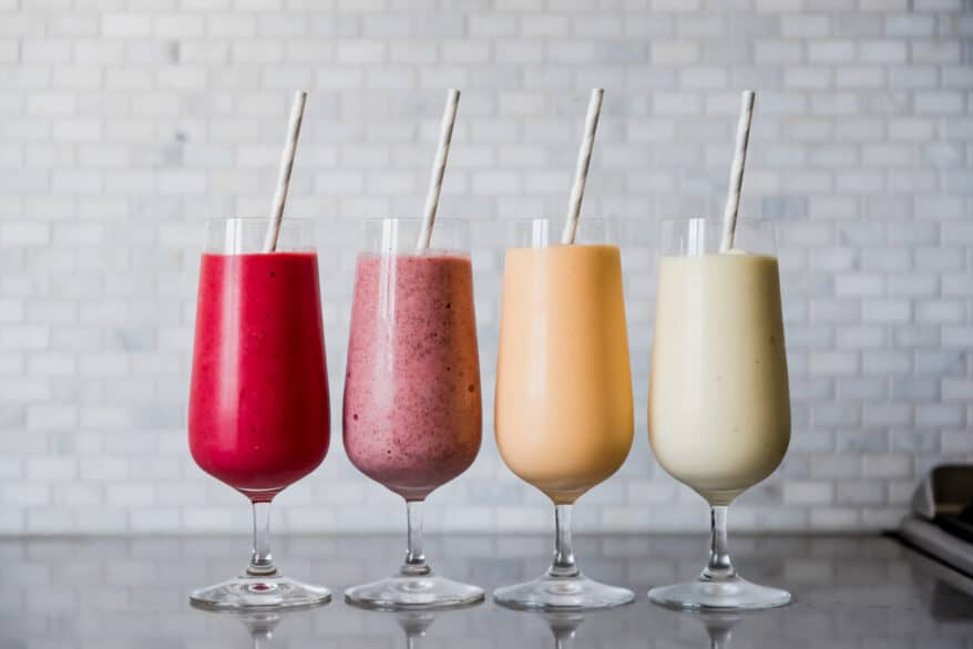 Four glass of four different types of summer smoothies. Photography by Gabrielle Touchette