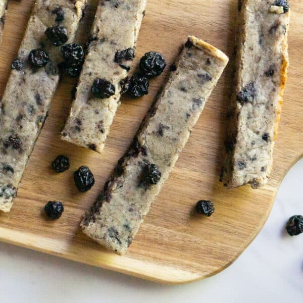 wooden serving board with soft baked blueberry almond snack bars